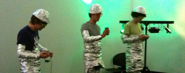 Students in tinfoil outfits performing